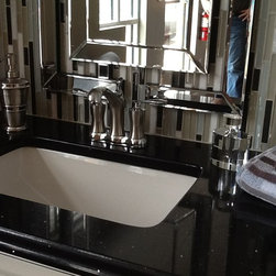 Pompeii Quartz Sparkle Black (Innovative Cabinetry, Ft Myers) - Sparkle Black is one of the many colors that we carry here at UMI. Pompeii Quartz is a great way to bring your bathroom/Kitchen Etc. together.
