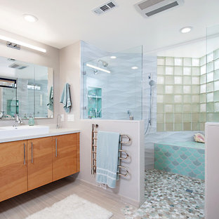 Pony walls with Glass Panels Allow The Shower to Shine