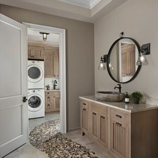 Inspiration for a mid-sized transitional porcelain floor and gray floor bathroom remodel in Detroit with louvered cabinets, beige cabinets, gray walls, a vessel sink and beige countertops