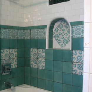 This is an example of a medium sized mediterranean shower room bathroom in Los Angeles with an alcove bath, a shower/bath combination, a one-piece toilet, blue tiles, white tiles and ceramic tiles.