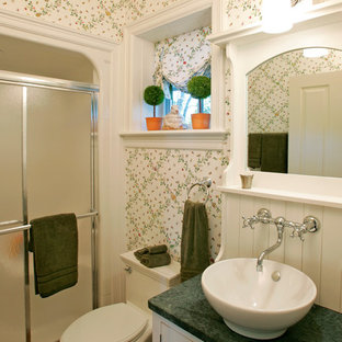 This is an example of a small traditional bathroom in Philadelphia with a vessel sink, white cabinets, granite benchtops, an alcove shower, white walls, terra-cotta floors, louvered cabinets and green benchtops.