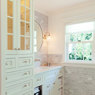 Inspiration for a traditional bathroom in Minneapolis with white tiles and stone tiles.