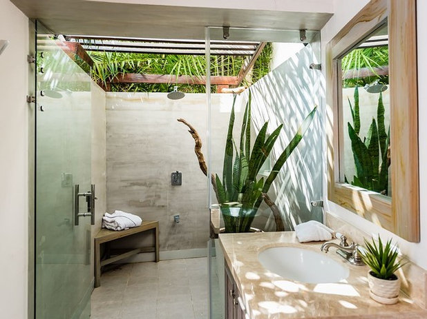 Tropical Bathroom by Costa Construction Company
