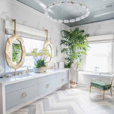 Eclectic 3/4 white tile multicolored floor freestanding bathtub photo in Seattle with flat-panel cabinets, blue cabinets, white walls and an undermount sink