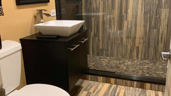 """Porcelain tile """"wood plank look """" installed on bathroom floor / two walls with m"""