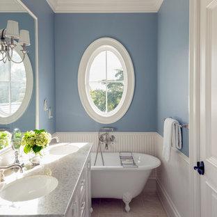 Imagen de cuarto de baño con ducha, costero, grande, con armarios con paneles empotrados, puertas de armario blancas, encimera de granito, bañera con patas, baldosas y/o azulejos grises, baldosas y/o azulejos de piedra, paredes azules, suelo de mármol y lavabo bajoencimera