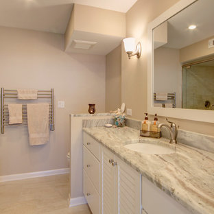 Beach style multicolored tile and porcelain tile alcove shower photo in Miami with an undermount sink, louvered cabinets, white cabinets, granite countertops and a two-piece toilet