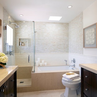 Mid-sized trendy master multicolored tile porcelain tile corner shower photo in Los Angeles with an undermount sink, furniture-like cabinets, medium tone wood cabinets, quartz countertops, an undermount tub, a two-piece toilet and white walls