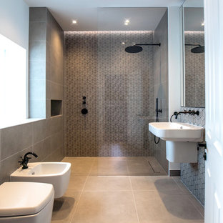 Inspiration for a contemporary bathroom in London with a built-in shower, a bidet, grey tiles, white walls, a wall-mounted sink, grey floors and an open shower.