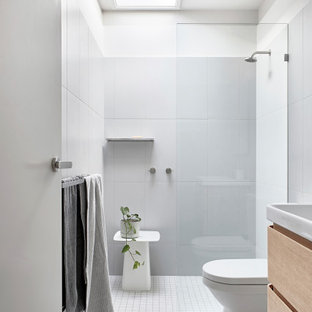 Contemporary bathroom in Melbourne with flat-panel cabinets, light wood cabinets, an alcove shower, gray tile, white walls, mosaic tile floors, a console sink, grey floor, an open shower, a single vanity and a floating vanity.