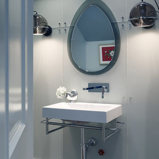 Inspiration for a contemporary glass sheet bathroom remodel in San Francisco with a wall-mount sink