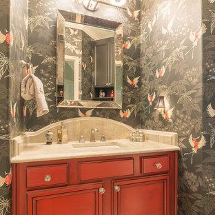 Bild på ett litet orientaliskt badrum med dusch, med luckor med infälld panel, röda skåp, flerfärgade väggar, mellanmörkt trägolv, ett undermonterad handfat och bänkskiva i kvartsit