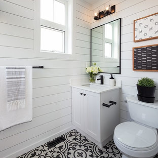 Inspiration for a small cottage cement tile floor and black floor bathroom remodel in Vancouver with shaker cabinets, white cabinets, a two-piece toilet, white walls, an undermount sink, quartzite countertops and white countertops