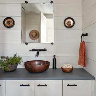 Inspiration for a mid-sized country bathroom in New York with a vessel sink, beige cabinets, beige walls, grey benchtops, wood and wood walls.