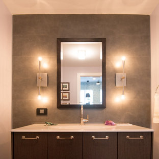 Example of a mid-sized trendy 3/4 gray tile and stone tile bathroom design in Chicago with an integrated sink, flat-panel cabinets, dark wood cabinets, a one-piece toilet and gray walls