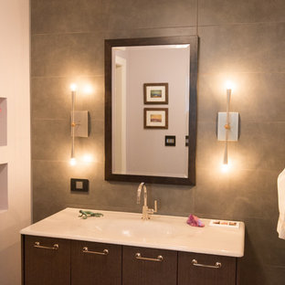 Inspiration for a mid-sized contemporary 3/4 gray tile and stone tile bathroom remodel in Chicago with an integrated sink, flat-panel cabinets, dark wood cabinets, a one-piece toilet, gray walls and glass countertops