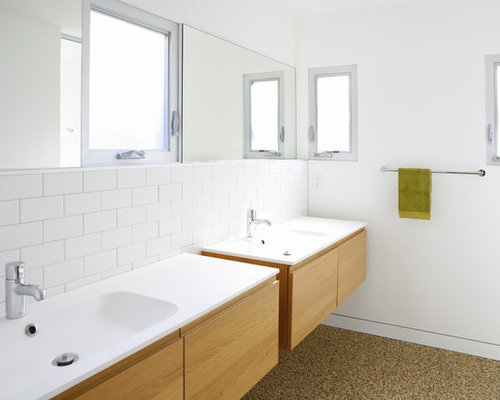 Modern Bathroom Idea In Los Angeles With An Integrated Sink Flat Panel Cabinets