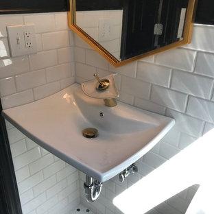 Foto di una piccola stanza da bagno minimalista con WC monopezzo, piastrelle bianche, piastrelle diamantate, pareti nere, pavimento con piastrelle in ceramica, lavabo sospeso e pavimento bianco