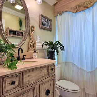 Inspiration for a mid-sized timeless 3/4 white tile and ceramic tile ceramic tile and white floor bathroom remodel in New Orleans with furniture-like cabinets, marble countertops, beige walls, distressed cabinets, a two-piece toilet and an undermount sink