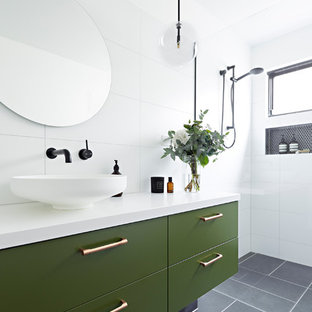 Inspiration for a mid-sized contemporary 3/4 bathroom in Melbourne with green cabinets, white tile, white walls, a vessel sink, grey floor, an open shower, white benchtops, an open shower, furniture-like cabinets, porcelain tile and engineered quartz benchtops.