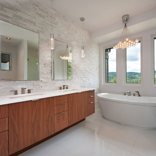 Design ideas for a contemporary bathroom in Vancouver with stone tiles.