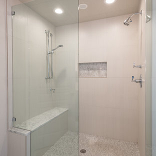 Mid-sized transitional master beige tile and porcelain tile porcelain floor bathroom photo in Dallas with shaker cabinets, beige cabinets, a one-piece toilet, beige walls, an undermount sink and marble countertops