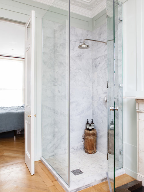 Inspiration For A Transitional Medium Tone Wood Floor Corner Shower Remodel  In London With Green Walls