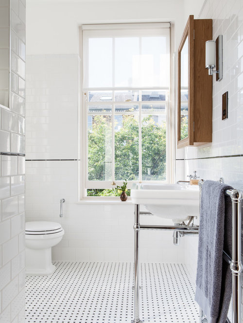 design ideas for a classic bathroom in london with a console sink a two