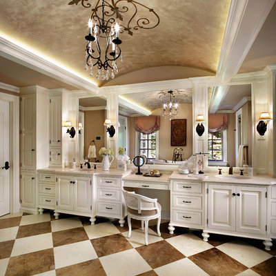 Example of a large classic limestone floor alcove shower design in New York with an undermount sink, white cabinets, beige walls, limestone countertops and raised-panel cabinets