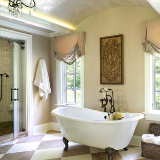 Example of a tuscan bathroom design in New York with beige walls