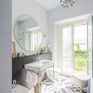 Design ideas for a mediterranean bathroom in Milan with a console sink, black tiles, mosaic tiles, white walls and ceramic flooring.