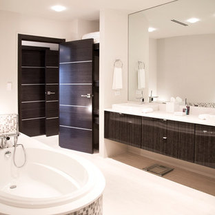 Inspiration For A Large Contemporary Gray Tile Bathroom Remodel In Other  With Flat Panel Cabinets