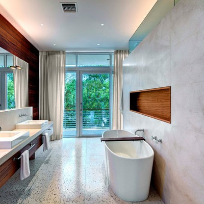 Freestanding bathtub - modern freestanding bathtub idea in Tampa with a vessel sink