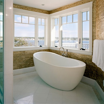 Trendy freestanding bathtub photo in Boston with brown walls