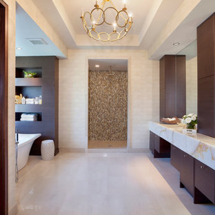 Inspiration for a large transitional master beige floor bathroom remodel in Miami with an undermount sink, flat-panel cabinets, dark wood cabinets, marble countertops and beige walls