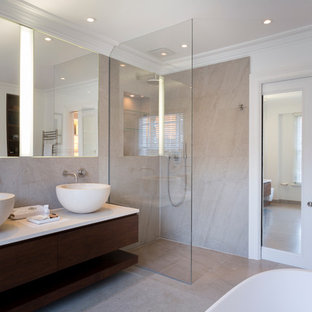 Photo of a medium sized contemporary ensuite bathroom in London with dark wood cabinets, a walk-in shower, beige tiles, stone slabs, white walls, marble flooring, marble worktops, a vessel sink and an open shower.