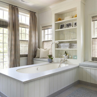 Transitional bathroom photo in Chicago with an undermount tub and white walls