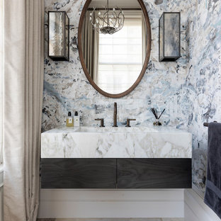 This is an example of a large contemporary bathroom in Wiltshire with grey walls, multi-coloured tiles, marble tiles, a wall-mounted sink and marble worktops.