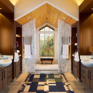 Imagen de cuarto de baño principal, rural, extra grande, con losas de piedra, armarios con paneles lisos, suelo de piedra caliza, encimera de mármol, puertas de armario marrones y baldosas y/o azulejos blancos