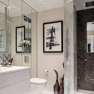 Medium sized contemporary bathroom in Berkshire with flat-panel cabinets, white cabinets, a walk-in shower, a wall mounted toilet, beige walls, a wall-mounted sink, white floors and an open shower.