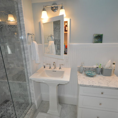 Alcove shower - mid-sized traditional 3/4 gray tile and stone tile marble floor alcove shower idea in Boston with shaker cabinets, white cabinets, a one-piece toilet, blue walls, a pedestal sink and quartzite countertops