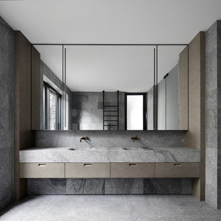 Inspiration for a modern bathroom in Los Angeles with flat-panel cabinets, grey cabinets, gray tile, red walls, an integrated sink, grey floor and grey benchtops.