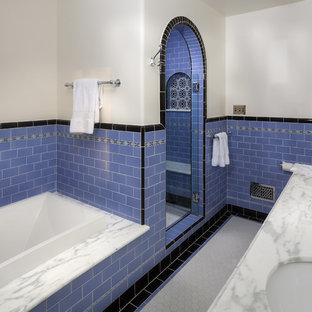 Inspiration for a large mediterranean ensuite bathroom in Los Angeles with a submerged sink, shaker cabinets, white cabinets, marble worktops, a built-in bath, an alcove shower, a two-piece toilet, blue tiles, ceramic tiles, white walls and ceramic flooring.