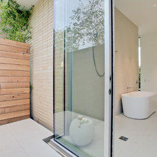 Modern Bathroom by Dwellings