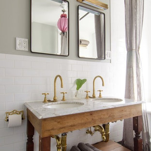 Cottage chic white tile and subway tile bathroom photo in New York with an undermount sink, open cabinets and gray walls