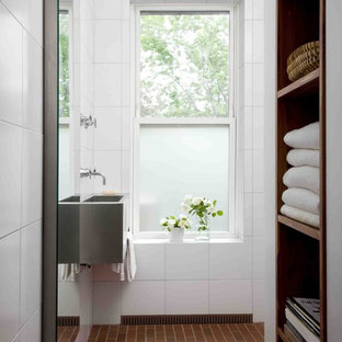Walk-in shower - small contemporary white tile and porcelain tile brick floor walk-in shower idea in New York with a wall-mount sink, white walls, open cabinets, stainless steel countertops and dark wood cabinets