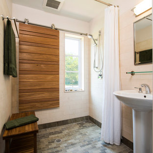 Photo of a contemporary bathroom in Philadelphia with a pedestal sink, a built-in shower and white tiles.
