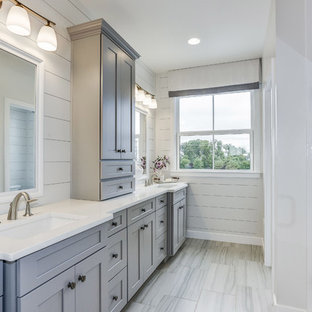 Example of a country gray floor bathroom design in DC Metro with shaker cabinets, gray cabinets, gray walls, an undermount sink, a hinged shower door and white countertops