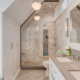 Cottage 3/4 white tile gray floor alcove shower photo in Boston with raised-panel cabinets, white cabinets, white walls, an undermount sink, a hinged shower door and gray countertops