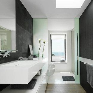 Idee per una stanza da bagno con doccia minimal di medie dimensioni con lavabo rettangolare, ante lisce, ante bianche, piastrelle nere e pareti nere